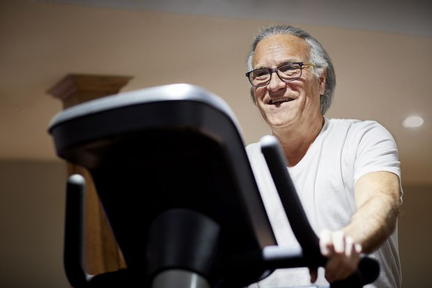 Brain Mandelker cycling on a stationary bike to treat lumbar spinal stenosis