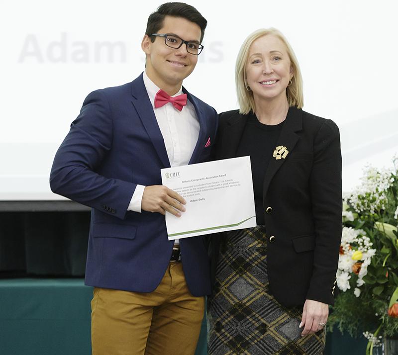 Caroline Brereton, CEO, OCA, presenting award to Adam Solis