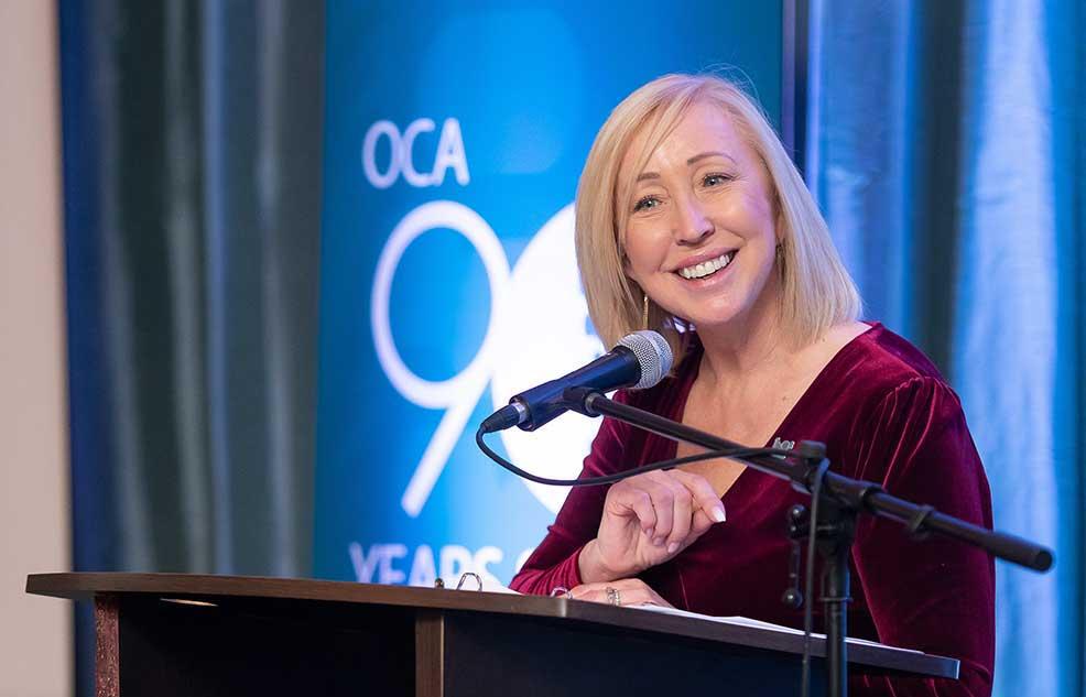 Caroline Brereton, Ontario Chiropractic Association CEO at podium