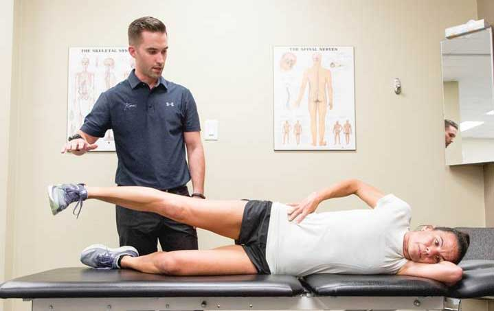 Dr. Welsh delivering chiropractic care to one of many office athletes