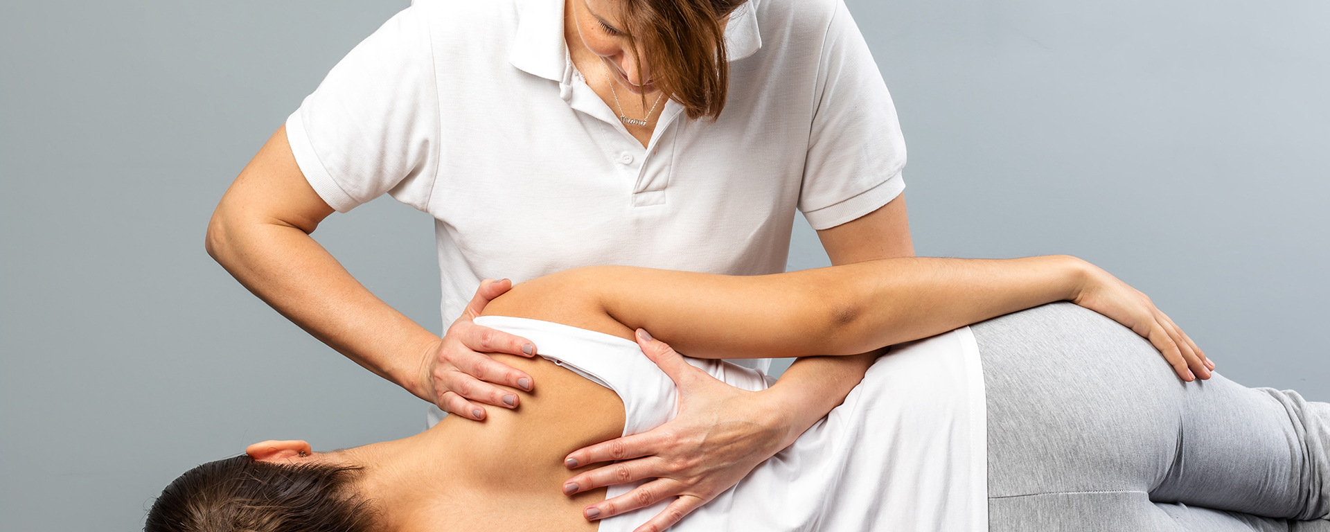 patient lying on side with chiropractor doing an adjustment