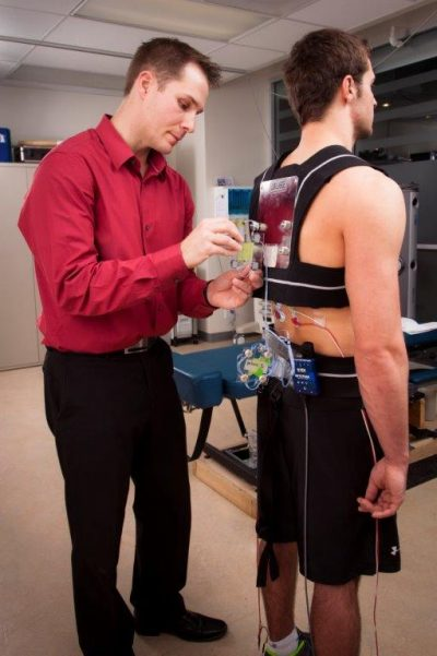 Dr. Sam Howarth with patient in CMCC's Human Performance Lab