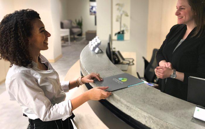 Nardine speaking to clinic receptionist
