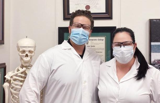chiropractors in masks at Wasaga clinic